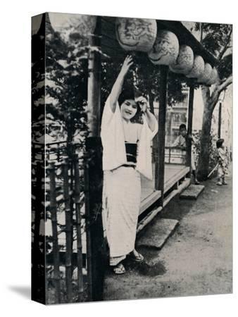 'Sweet natured smile of tea-house maid, called nesan - elder sister', c1900, (1921)-Julian Leonard Street-Stretched Canvas Print