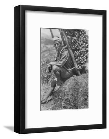 'Middle-aged coolie hurriedly seated himself on the bank to pass us in review', c1900, (1921)-Julian Leonard Street-Framed Photographic Print