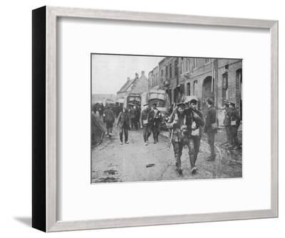 'The British wounded returning to a dressing station after an attack', 1915-Unknown-Framed Photographic Print