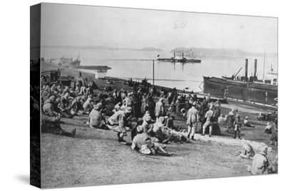 ''Austrian prisoners taken by Serbians resting at mid-day on the banks of the Danube', 1915-Unknown-Stretched Canvas Print
