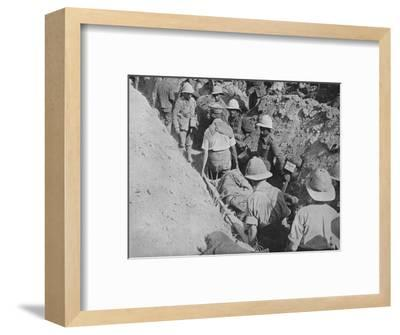 'Carrying wounded through the trenches', 1915-Unknown-Framed Photographic Print