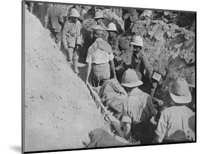 'Carrying wounded through the trenches', 1915-Unknown-Mounted Photographic Print