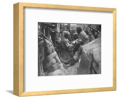 'First aid to a wounded man in one of the French trenches', 1915-Unknown-Framed Photographic Print