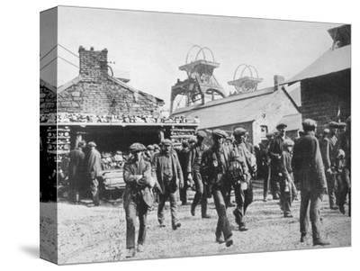 'Miners leaving the pithead after the expiration of their strike notices', 1915-Unknown-Stretched Canvas Print