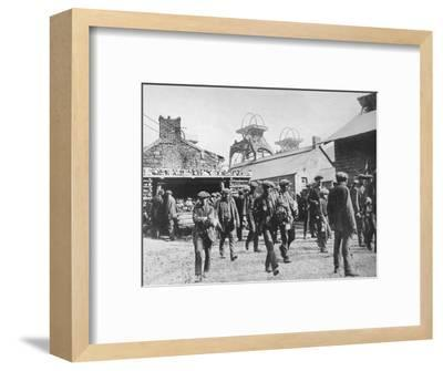 'Miners leaving the pithead after the expiration of their strike notices', 1915-Unknown-Framed Photographic Print