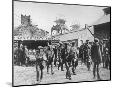 'Miners leaving the pithead after the expiration of their strike notices', 1915-Unknown-Mounted Photographic Print