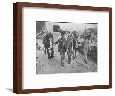 'After the settlement: Miners taking their ponies back to the pit', 1915-Unknown-Framed Photographic Print
