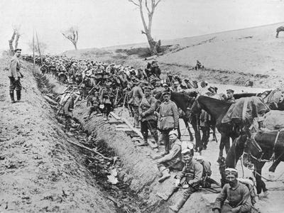 'The German advance through Galicia: A bivouac of troops by the roadside', 1915-Unknown-Framed Photographic Print