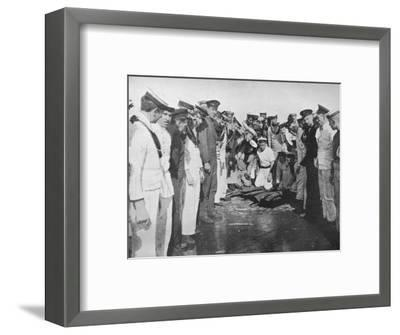 'British sailors round a hole in the deck of their vessel', 1915-Unknown-Framed Photographic Print