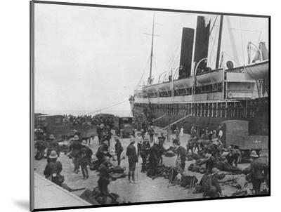 'The Dardanelles Expeditionary Force sets out: A transport loading up at Alexandria', 1915-Unknown-Mounted Photographic Print