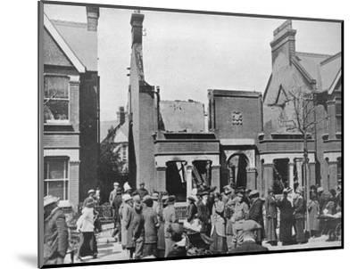 'The result of an air raid: A wrecked house in Southend', 1915-Unknown-Mounted Photographic Print