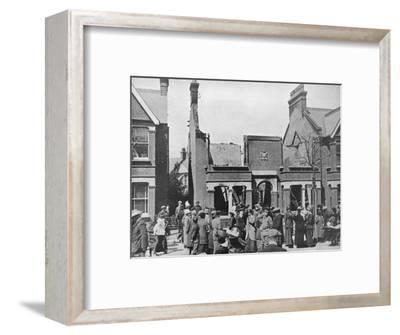 'The result of an air raid: A wrecked house in Southend', 1915-Unknown-Framed Photographic Print