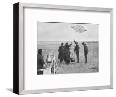 'Sending up one of the French war kites, to which a camera is attached', 1914, (1915)-Unknown-Framed Photographic Print