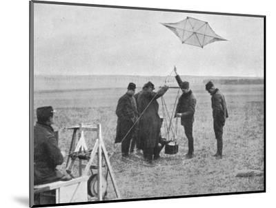 'Sending up one of the French war kites, to which a camera is attached', 1914, (1915)-Unknown-Mounted Photographic Print