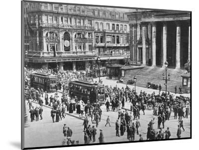 'A view of the Bourse during the passage of the German troops', 1914-Unknown-Mounted Photographic Print