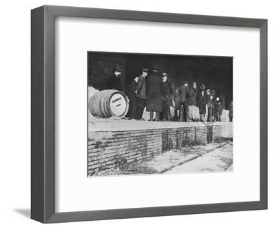 'After the Declaration of War: German beer being run away at an Italian Customs store', 1915-Unknown-Framed Photographic Print