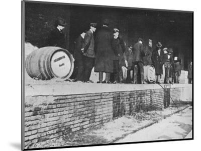 'After the Declaration of War: German beer being run away at an Italian Customs store', 1915-Unknown-Mounted Photographic Print