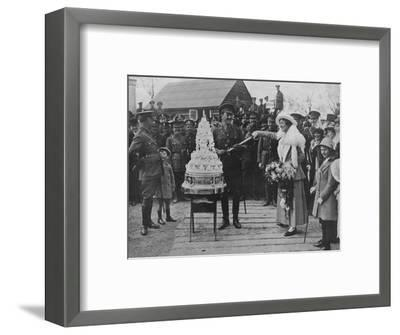 'A khaki wedding: Cutting the wedding cake with the bridegroom's sword', 1915-Unknown-Framed Photographic Print