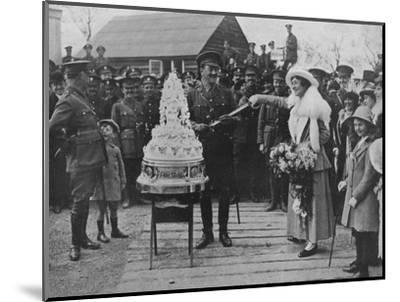 'A khaki wedding: Cutting the wedding cake with the bridegroom's sword', 1915-Unknown-Mounted Photographic Print