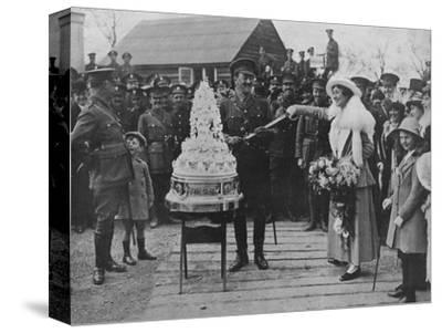 'A khaki wedding: Cutting the wedding cake with the bridegroom's sword', 1915-Unknown-Stretched Canvas Print