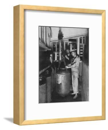 'Taking a submarine mine out of stores', 1914-Unknown-Framed Photographic Print