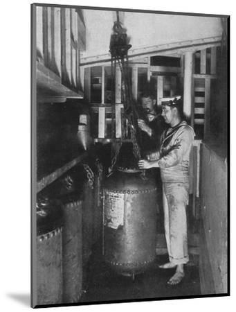 'Taking a submarine mine out of stores', 1914-Unknown-Mounted Photographic Print