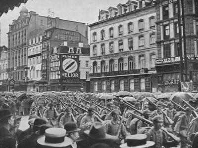 'German infantry entering Brussels in the rain', 1914-Unknown-Framed Photographic Print