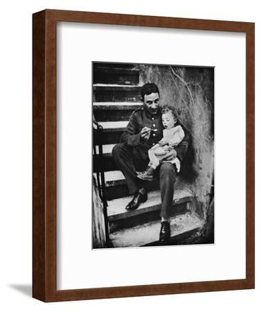 'One of the New Army making himself useful in his billet', 1915-Unknown-Framed Photographic Print