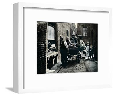 A move in 'Slumopolis', London, c1901 (1901)-Unknown-Framed Photographic Print