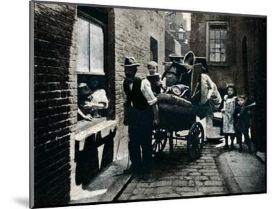 A move in 'Slumopolis', London, c1901 (1901)-Unknown-Mounted Photographic Print