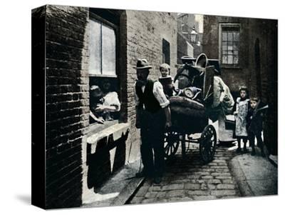 A move in 'Slumopolis', London, c1901 (1901)-Unknown-Stretched Canvas Print
