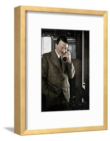 Adolf Hitler on the telephone, January 1935-Unknown-Framed Photographic Print