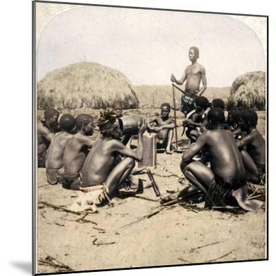 'Braves of a Zulu Village holding a Council, near the Umlaloose River, Zululand, S.A.', 1901-Unknown-Mounted Photographic Print