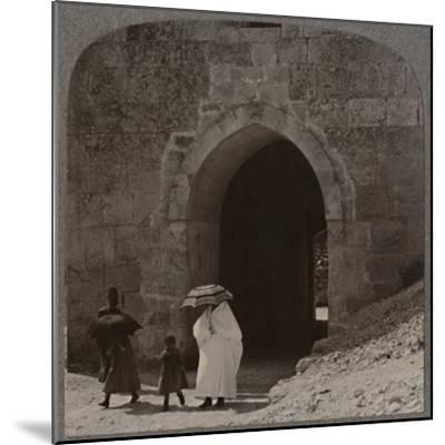 'Mahommedan women entering Jerusalem by Herod's Gate', c1900-Unknown-Mounted Photographic Print