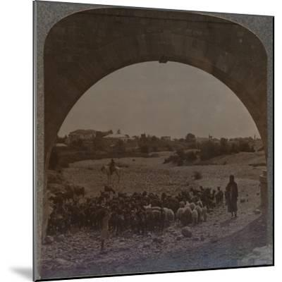 'Aqueduct showing Jericho through Arch', c1900-Unknown-Mounted Photographic Print