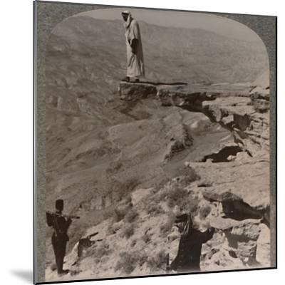 'The Arno. Dragoman standing on rock', c1900-Unknown-Mounted Photographic Print