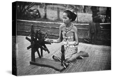 A Dayak girl at her spinning wheel, 1902-Unknown-Stretched Canvas Print
