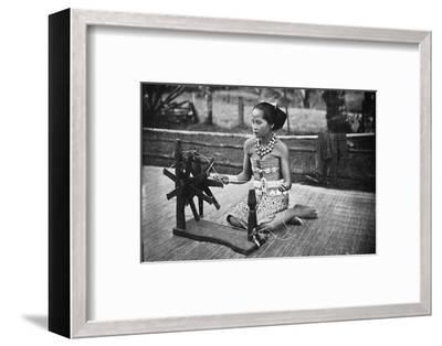 A Dayak girl at her spinning wheel, 1902-Unknown-Framed Photographic Print