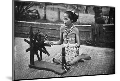 A Dayak girl at her spinning wheel, 1902-Unknown-Mounted Photographic Print