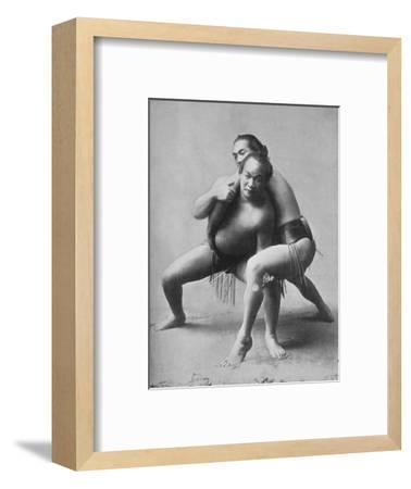 A sumo wrestling bout between a pair of Japanese professionals, 1902-Unknown-Framed Photographic Print