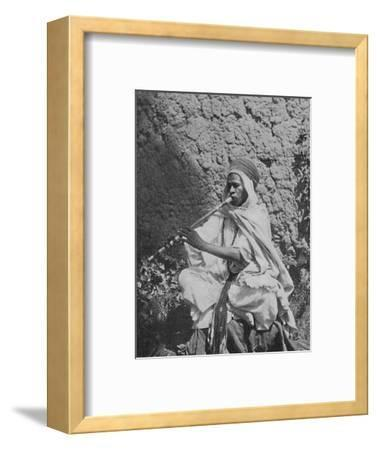 Algerian native flute player, 1912-Unknown-Framed Photographic Print