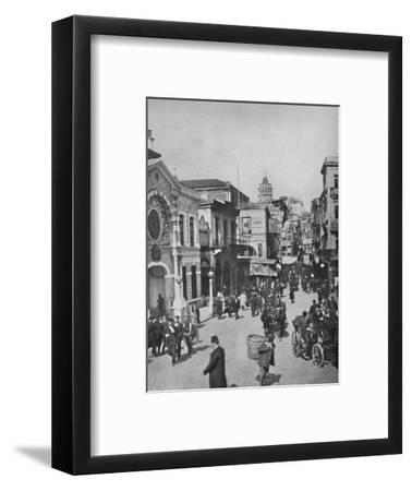 'Street vista in Galata from end of bridge, Constantinople', 1913-Unknown-Framed Photographic Print