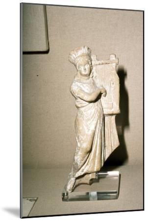 Greek Terracotta, Woman playing Kithera with plectrum, 3rd century BC-2nd century BC-Unknown-Mounted Giclee Print