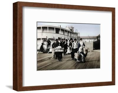 Immigrants to the USA landing at Ellis Island, New York, c1900-Unknown-Framed Photographic Print
