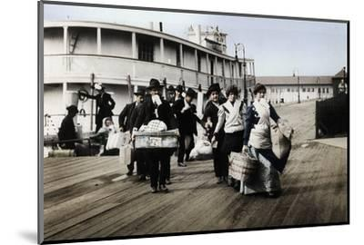Immigrants to the USA landing at Ellis Island, New York, c1900-Unknown-Mounted Photographic Print