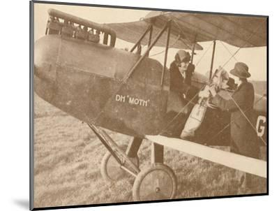 'By Air to the Golf Links in a Little 27-60 HP 'Moth' Light 'Plane', 1927-Unknown-Mounted Photographic Print