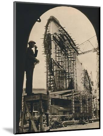 'The Massive Hull, partly placed', 1930-1934, (1936)-Unknown-Mounted Photographic Print