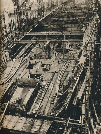 'More than 1,000 Feet Long. Shell of Queen Mary in early days of construction', 1930-1934, (1936)-Unknown-Framed Photographic Print