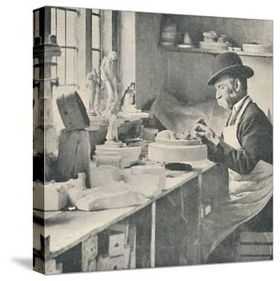'Trimming up parts of raw clay', c1917-Unknown-Stretched Canvas Print