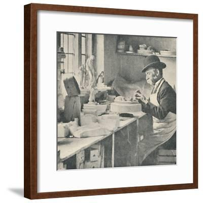 'Trimming up parts of raw clay', c1917-Unknown-Framed Photographic Print